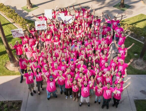 Top view of Scorpion employees wearing pink shirts